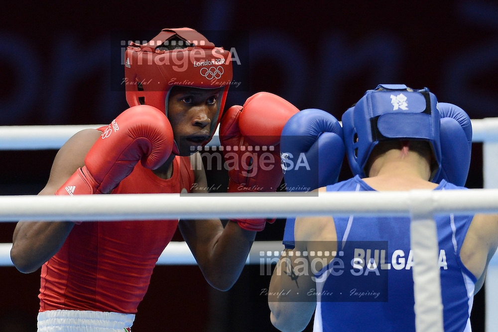 LONDON, ENGLAND - JULY 28, Ayabonga Sonjica of South Africa (Red) versus Detelin Dalakliev of Bulgaria (blue during the Mens Round of 32 Bantam 56kg boxing match at Excel, South Arena 2 on July 28, 2012 in London, England.Photo by Roger Sedres / Gallo Images