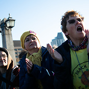 Thousands of Extinction Rebellion activists took over 5 bridges in Central London and blocked them for the day, November 17 2018, Central London, United Kingdom. Lambeth Bridge women from Lancashire and the anti-fracking movement cheer on the crowd sitting in the road on the bridge. Around 11am people on all bridges sat down in the road and blocked traffic from coming through and stayed till late afternoon. The actvists believe that the government is not doing enough to avoid catastrophic climate change and they demand the government take radical action to save future generations and the planet.Many are willing to be arrested peacefully protesting and up to 80 were arrested on the day. Extinction Rebellion is a grass root climate change group started in 2018 and has gained a huge following of people commited to peaceful protests and who ready to be arrested. Their major concern is that the world is facing catastropohic climate change and they want the British government to act now to save future generations.