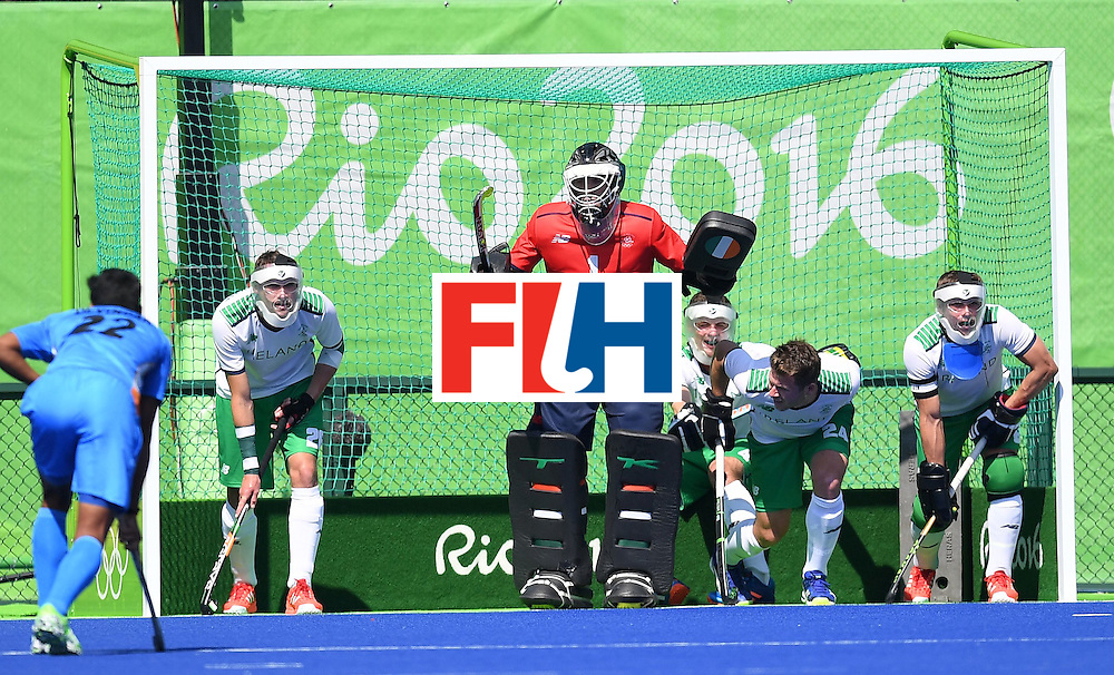 Ireland's David Harte (C) and teammates defend their goal during the men's field hockey India vs Ireland match of the Rio 2016 Olympics Games at the Olympic Hockey Centre in Rio de Janeiro on August, 6 2016. / AFP / MANAN VATSYAYANA        (Photo credit should read MANAN VATSYAYANA/AFP/Getty Images)