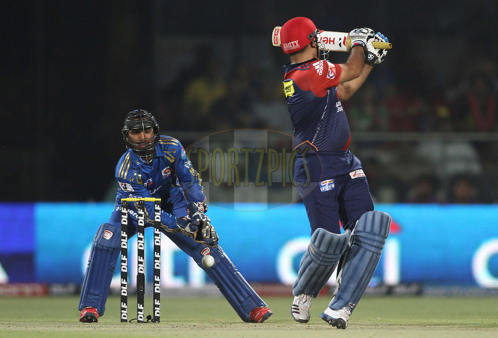 Dinesh Karthik of the Mumbai Indians misses a stumping chance during match 36 of the the Indian Premier League (IPL) 2012  between The Delhi Daredevils and the Mumbai Indians held at the Feroz Shah Kotla, Delhi on the 27th April 2012..Photo by Shaun Roy/IPL/SPORTZPICS