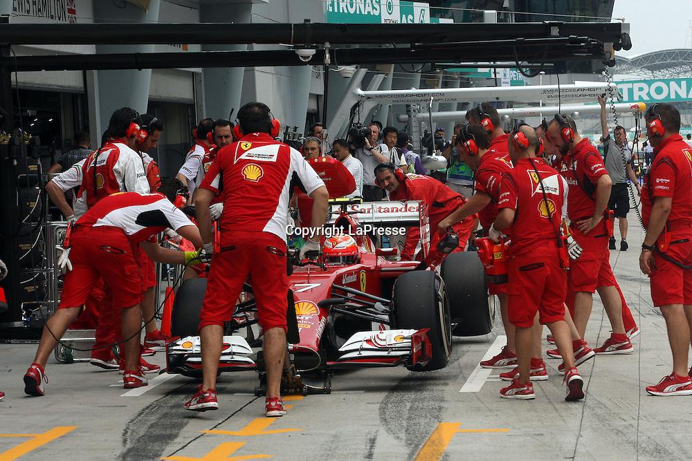 &copy; Photo4 / LaPresse<br /> 29/3/2014 Sepang, Malaysia<br /> Sport <br /> Grand Prix Formula One Malaysia 2014<br /> In the pic: pit stop testing for Kimi Raikkonen (FIN) Scuderia Ferrari F14-T