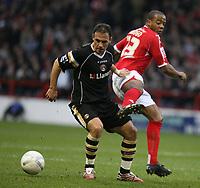 Photo: Pete Lorence.<br />Nottingham Forest v Charlton Athletic. The FA Cup. 06/01/2007.<br />Radostin Kishishev darts around Junior Agogo.