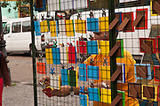 A vendor sells curios in Caminito street, in La Boca neighborhood of Buenos Aires, Argentina.<br /> Caminito is a pedestrian street created in the late 1950s by local painter Benito Quinquela Martín and other artist friends to recreate a version of the old immigrant neighborhood of La Boca, using wood and corrugated zinc painted in bright colors. Today, Caminito and the surrounding areas feature cafes, souvenir shops, tango dancers and other street performances aimed to attract tourists.