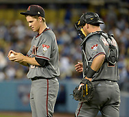 April 14, 2017 - Los Angeles, California, U.S. - Arizona Diamondbacks starting pitcher Zack Greinke talks with catcher Jeff Mathis in the second inning of a Major League baseball game against the Arizona Diamondbacks at Dodger Stadium on Friday, April 14, 2017 in Los Angeles. (Photo by Keith Birmingham, Pasadena Star-News/SCNG) (Credit Image: © San Gabriel Valley Tribune via ZUMA Wire)