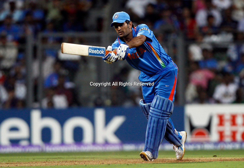 02.04.2011 Cricket World Cup Final from the Wankhede Stadium in Mumbai. Sri Lanka v India.Indian Captain Mahendra Singh Dhoni  plays a shot during the final match of the ICC Cricket World Cup between India and Sri Lanka on the 2nd April 2011