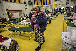 November 18, 2018 - Gridley, CA, USA - Dawn Heaton, 51, comforts her grand daughter Ariel Norton, 13 months, in the Red Cross shelter where evacuees from the Camp Fire can live inside a heated building at the Butte County Fairgrounds on Sunday, Nov. 18, 2018 in Gridley, Calif. She said officers came to her door and said she had 15 minutes to evacuate in Paradise. ''I watched the house burn as we drove away. I'm happy I found this place in the nick of time,'' said Heaton. (Credit Image: © Renee C. Byer/Sacramento Bee/TNS via ZUMA Wire)