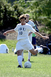 01 October 2006: Titan Paulo Michelini takes a restart kick. The game remained scoreless until the 2nd overtime in which University of Dallas Crusaders Adam Lunger scored the Golden Goal to beat the Illinois Wesleyan Titans.  This game was played at Neis Field on the campus of Illinois Wesleyan University in Bloomington Illinois.