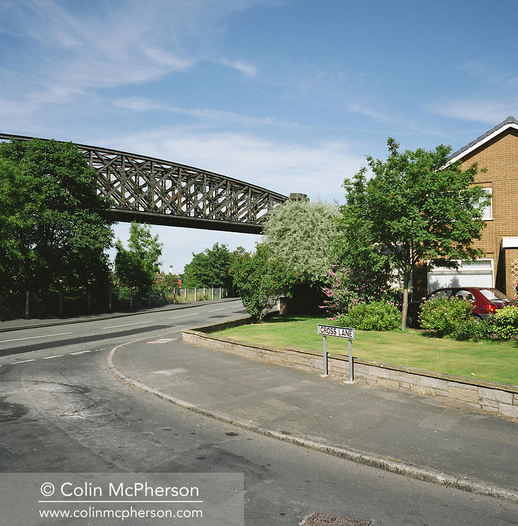 A disused railway viaduct at Latchford crossing the Manchester Ship Canal and adjacent to the river Mersey just west of Warrington. The Mersey is a river in north west England which stretches for 70 miles (112 km) from Stockport, Greater Manchester, ending at Liverpool Bay, Merseyside. For centuries, it formed part of the ancient county divide between Lancashire and Cheshire.