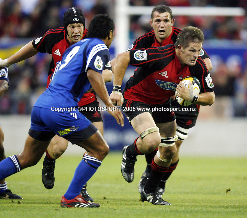 Crusaders captain Richie McCaw on the attack during the 2006 Super 14 Rugby Union match between the Crusaders and the Blues at Jade Stadium, Christchurch, on Saturday 4 March 2006. Photo: Anthony Phelps/PHOTOSPORT<br /><br /><br />148425