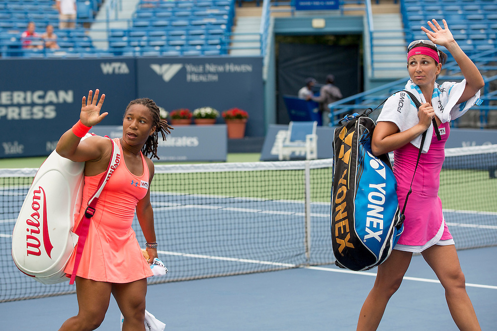 August 22, 2014, New Haven, CT:<br /> Megan Moulton-Levy and Darija Jurak wave to teh crowd after being defeating by Andreja Klepac and Silvia Soler-Espinosa in the doubles semi-finals on day eight of the 2014 Connecticut Open at the Yale University Tennis Center in New Haven, Connecticut Friday, August 22, 2014.<br /> (Photo by Billie Weiss/Connecticut Open)
