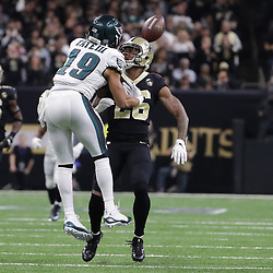 Jan 13, 2019; New Orleans, LA, USA; Philadelphia Eagles wide receiver Golden Tate (19) battles New Orleans Saints cornerback P.J. Williams (26) for a pass during the fourth quarter of a NFC Divisional playoff football game at Mercedes-Benz Superdome Mandatory Credit: Derick E. Hingle-USA TODAY Sports