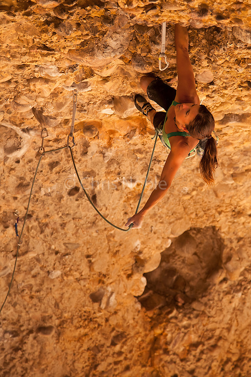 "Professional climber Brittany Griffith climbing ""Gong Show"" 12c, Maple Canyon Utah."
