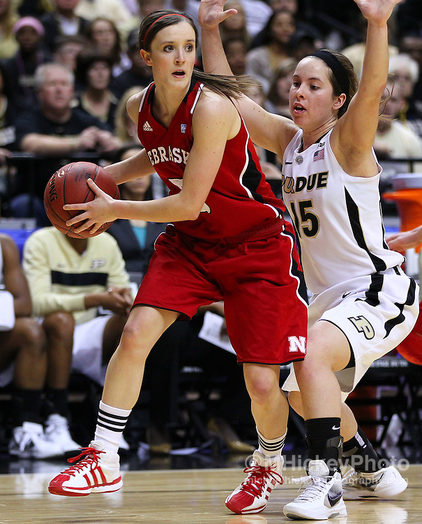March 04, 2012; Indianapolis, IN, USA; Nebraska Cornhuskers guard Kaitlyn Burke (5) looks to pass off the ball as Purdue Boilermakers guard Courtney Moses (15) guards during the finals of the 2012 Big Ten Tournament at Bankers Life Fieldhouse. Purdue defeated Nebraska 74-70 in 2OT. Mandatory credit: Michael Hickey-US PRESSWIRE