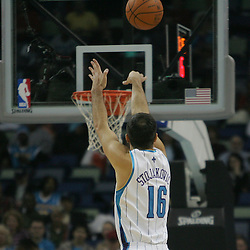 Jan 13, 2010; New Orleans, LA, USA; New Orleans Hornets forward Peja Stojakovic (16) shoots a three pointer against the Los Angeles Clippers during the second quarter at the New Orleans Arena. Mandatory Credit: Derick E. Hingle-US PRESSWIRE