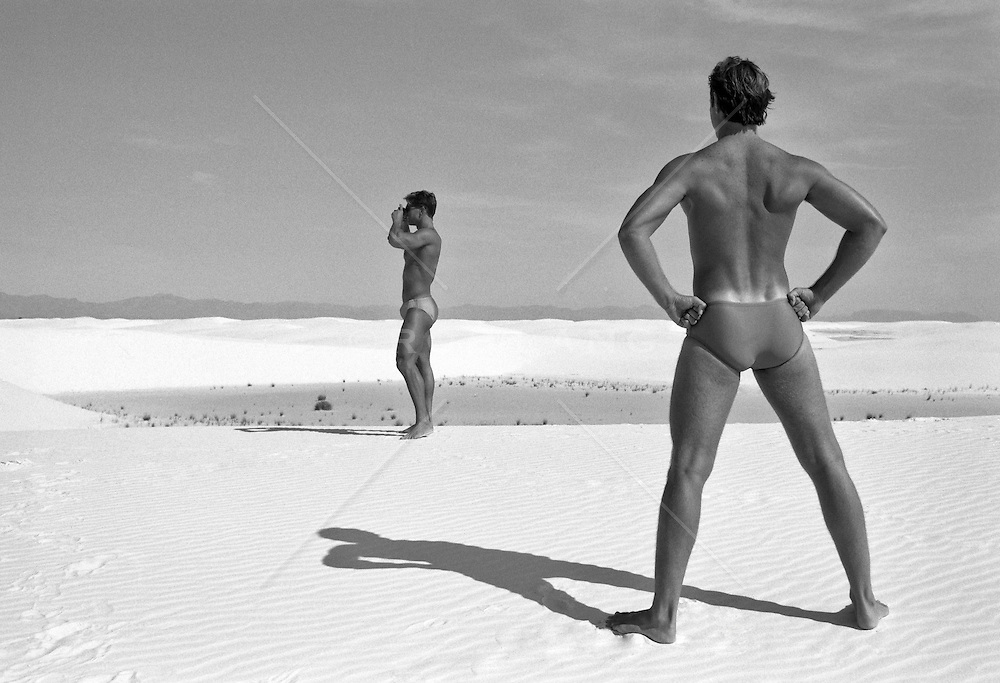two men in speedos in White Sands, NM