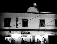 Hotel Colon, the brothel / hotel used by Paradita Erica, under a full moon, Coahuila District, Zona Norte, Tijuana, Mexico.  Paraditas are sex workers who may legally ply their trade in Zona Norte, less than 500 m from the Mexican / US border.