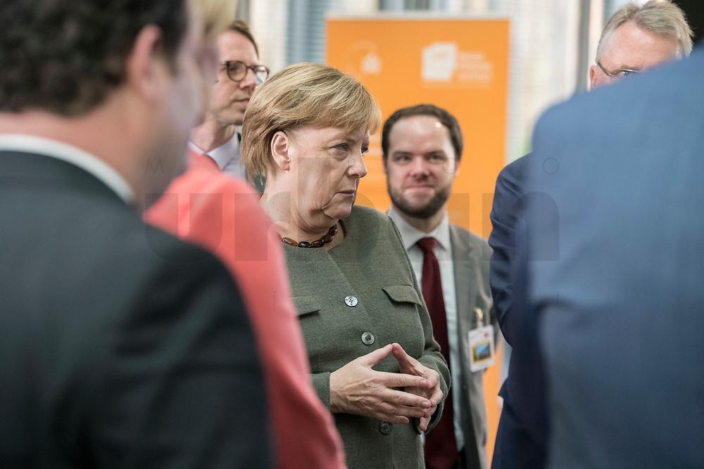 14 NOV 2018, POTSDAM/GERMANY:<br /> Angela Merkel, CDU, Bundeskanzlerin, waehrend einer Praesentation des HPI im Rahmen der Klausurtagung des Bundeskabinetts, Hasso Plattner Institut (HPI), Potsdam-Babelsberg<br /> IMAGE: 20181114-01-063<br /> KEYWORDS; Kabinett, Klausur, Tagung, muede, müde