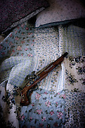 an antique rifle on a vintage bed