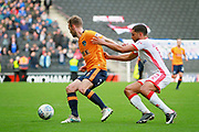 Oldham Athletic defender Cameron Dummigan (2) and MK Dons Scott Golbourne (12)  during the EFL Sky Bet League 1 match between Milton Keynes Dons and Oldham Athletic at stadium:mk, Milton Keynes, England on 21 October 2017. Photo by Nigel Cole.
