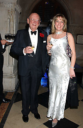 MR CHRISTOPHER SHAW and KIM URLICH at Andy & Patti Wong's annual Chinese New Year party, this year celebrating the year of the dog held at The Royal Courts of Justice, The Strand, London WC2 on 28th January 2006.<br /><br />NON EXCLUSIVE - WORLD RIGHTS