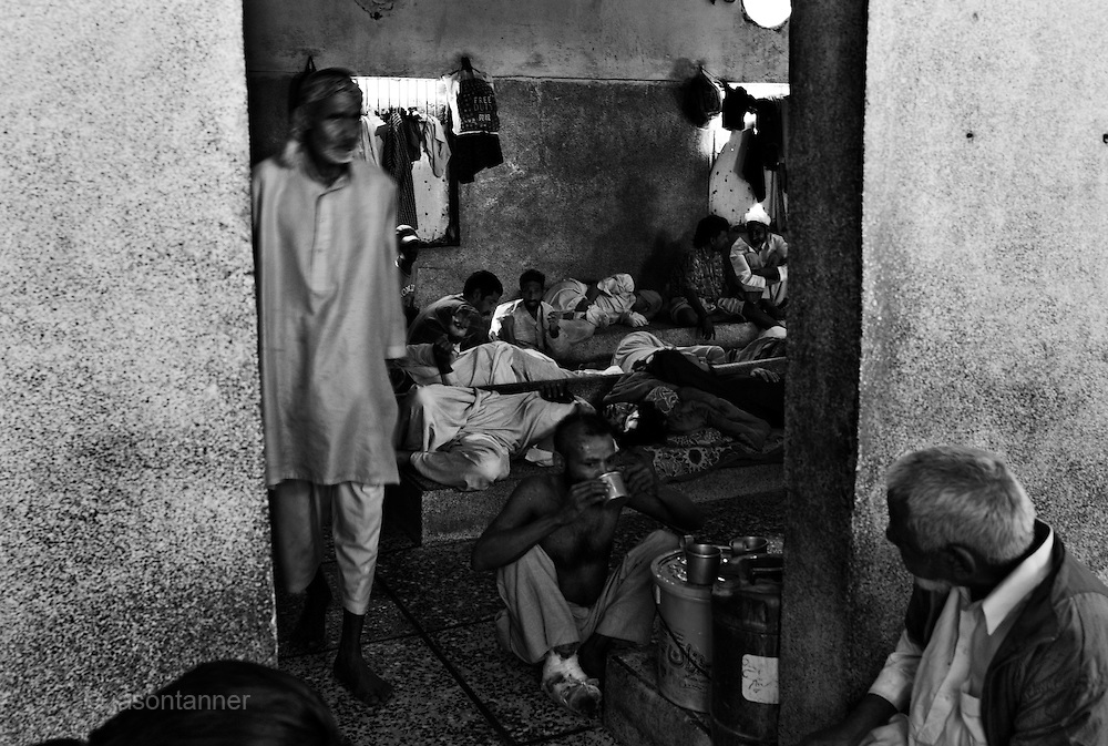 Recovering drug addicts (Male) sit around in their room at an Edhi Home facility in Karachi. Some may leave the home but many are homeless or destitute so chose to stay on at the facility after rehabilitation. No special treatment or medicine is offered, the treatment is 'cold turkey'...In a country of some 160 million people, affordable medicines and diagnostic tests are beyond the reach of most people in Pakistan. The country suffers from shortage of doctors and government funded healthcare facilities; to many  on low income levels, basic health care is a luxury. The rich and middle class get the best treatment whilst the poor reply on the work of a welfare trust by the name Edhi Foundation. ..The Edhi foundation was established by Abdul Sattar Edhi. Born in a small Indian own of Bantva in the province of Gujrat he migrated to Pakistan during partition in 1947. After working as a commissioning agent selling cloth in a market in Karachi Abdul Sattar Edhi and other members of his community decided to establish a free dispensary in the city. Disillusionment with the lack of health care led him to establish a welfare trust of his own called the Abdul Sattar Edhi Foundation. Appeals were made, funds raised and soon a home was established and a number of ambulances patrolled the streets of Karachi...In 1965 Adbul married a nurse working at the foundation, Bilquis. They have four children and all are involved in the current day to day running of the foundation. Bilquis Edhi runs a maternity home at the headquarters in Karachi and organises the adoption of illegitimate children and abandoned babies. The family share the foundation's vision of a single minded devotion to the cause of alleviation of human sufferings and a sense of personal responsibility. The foundation responds for calls of help from ordinary people, regardless of race, creed or status and now provides a priceless welfare service to the people of Pakistan...The foundation currently operates a fleet of 1200