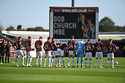 The players line  up and pay respects to former Northampton Town Chairman Bob Church MBE during the EFL Sky Bet League 2 match between Northampton Town and Newport County at the PTS Academy Stadium, Northampton, England on 14 September 2019.