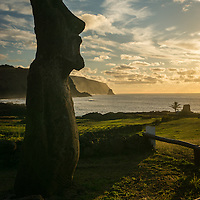 Easter Island is an island of Chile in the southeastern Pacific Ocean.  The island is famous for carved stone humanoid statues called moai created by the Rapa Nui people.