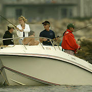 President Bush, center, daughter Jenna Bush, left,  and father former President George H.W. Bush fish near the family home July 7, 2002, in Kennebunkport, Maine.  President Bush is spending the Independence Day weekend in Kennebunkport, Maine, home of his parents...Photo by Khue Bui