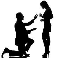 one caucasian couple man kneeling offering engagement ring and woman happy surprised in studio silhouette isolated on white background