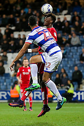 Tammy Abraham of Bristol City is challenged by Steven Caulker of Queens Park Rangers as he attempts a headed shot - Rogan Thomson/JMP - 18/10/2016 - FOOTBALL - Loftus Road Stadium - London, England - Queens Park Rangers v Bristol City - Sky Bet EFL Championship.
