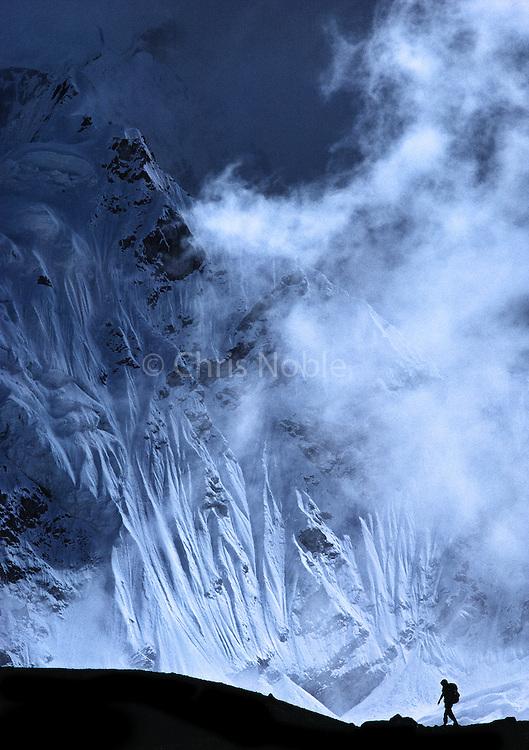 Walking on the Khumbu Glacier, a trekker approaches Everest Basecamp, Khumbu Glacier, Khumbu Himal, Nepal