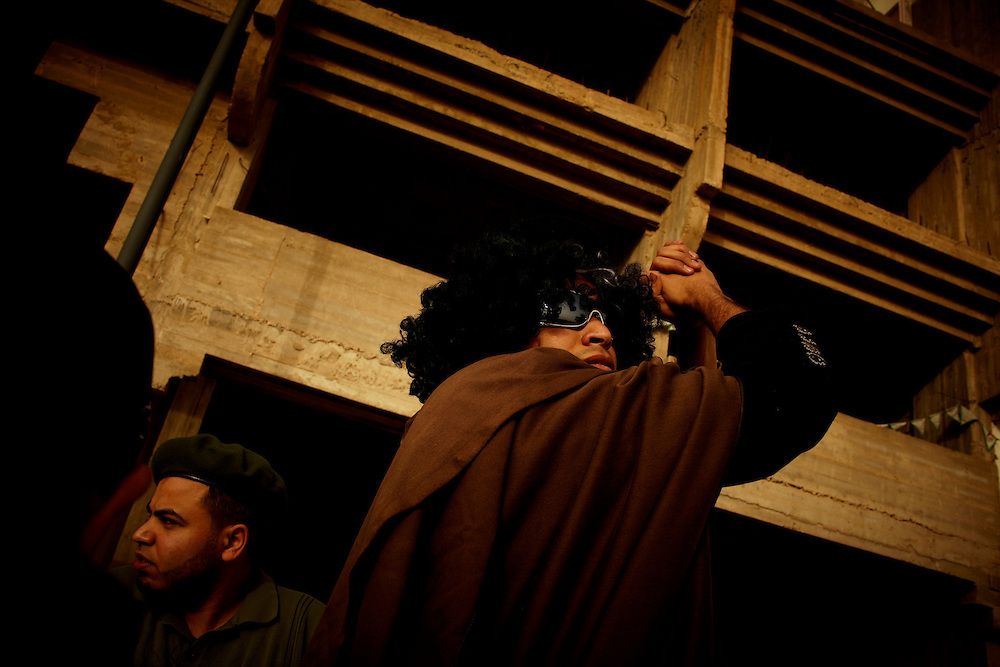 Benghazi, Libya, 02.03.11..A protestor dressed up as Ghadaffi...Photo by: Eivind H. Natvig/MOMENT