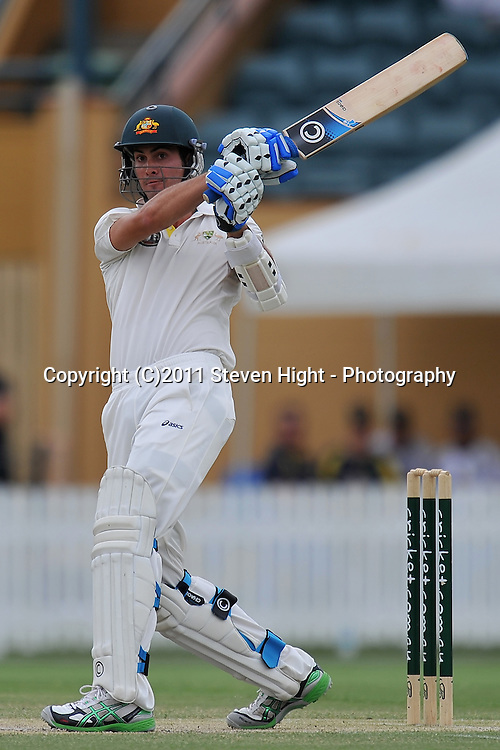 Ben Cutting follows through after nailing a big six during action from Day 3 of the Tour match between Australia A and New Zealand played at Allan Border Field from 24th - 27th November 2011~ Photo Credit Required : Steven Hight (AURA Images) ~ Editorial Use only in accordance with CA Terms & Conditions (2011-12)