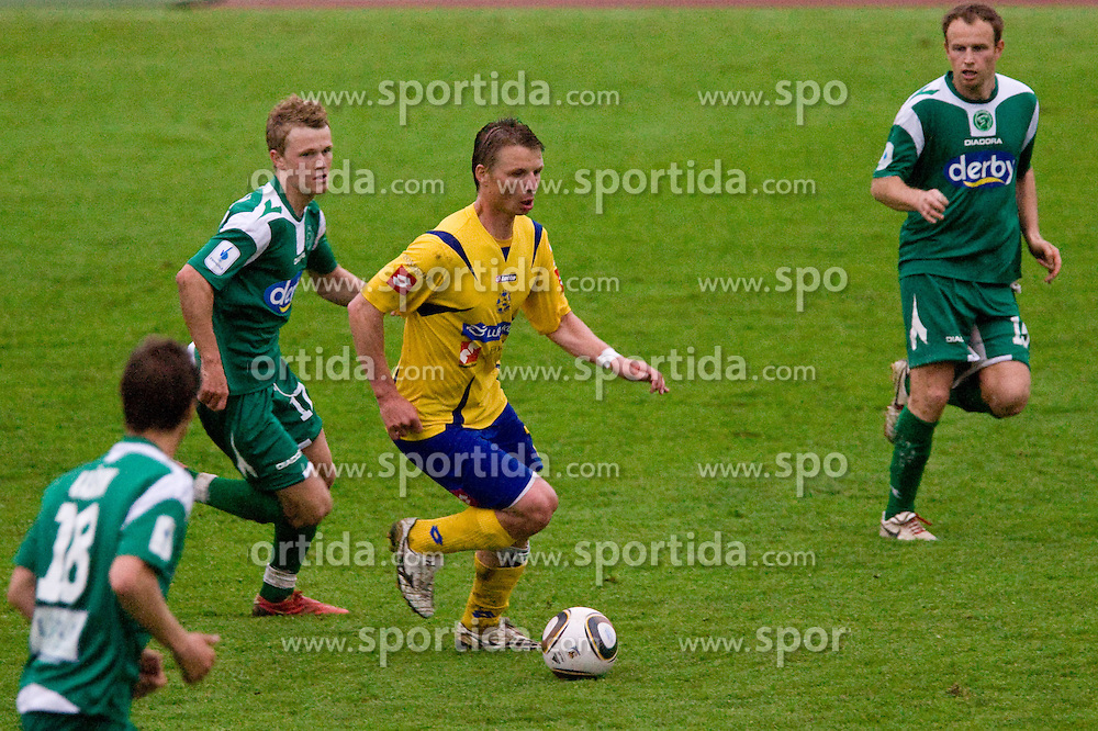 Nik Omladic of Olimpija vs Dare Vrsic of Koper at 34th Round of 1st Slovenian Football League match between NK Olimpija and NK Luka Koper, on May 5, 2010, in ZAK, Ljubljana, Slovenia.  (Photo by Vid Ponikvar / Sportida)