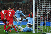 Liverpool goalkeeper Simon Mignolet (22)  saves from Manchester City midfielder Yaya Toure (42)  during the Capital One Cup match between Liverpool and Manchester City at Anfield, Liverpool, England on 28 February 2016. Photo by Simon Davies.