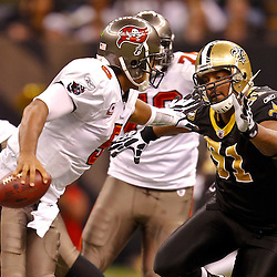 January 2, 2011; New Orleans, LA, USA; New Orleans Saints defensive end Will Smith (91) pursues Tampa Bay Buccaneers quarterback Josh Freeman (5)during the third quarter at the Louisiana Superdome. Mandatory Credit: Derick E. Hingle