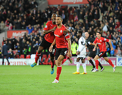 Cardiff City's Steven Caulker celebrates his winning goal with Cardiff City's Kevin Theophile Catherine - Photo mandatory by-line: Joe Meredith/JMP - Tel: Mobile: 07966 386802 03/11/2013 - SPORT - FOOTBALL - The Cardiff City Stadium - Cardiff - Cardiff City v Swansea City - Barclays Premier League