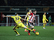 Brentford midfielder Alan Judge trying to find a way through during the Sky Bet Championship match between Brentford and Burnley at Griffin Park, London, England on 15 January 2016. Photo by Matthew Redman.