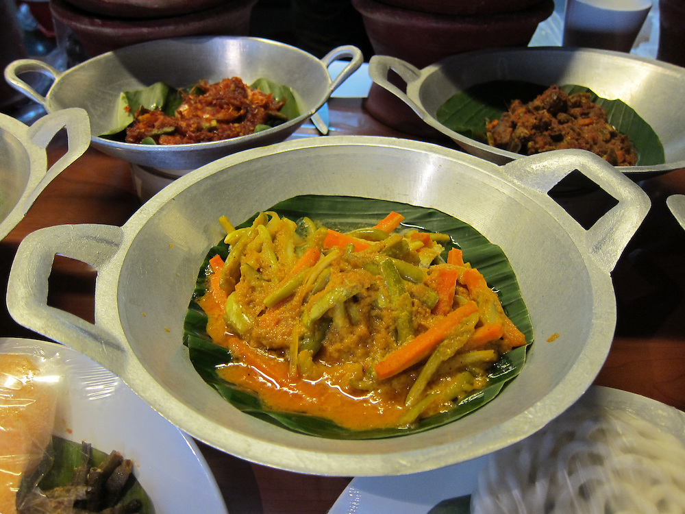 Acar, an Indonesian salad of pickled vegetables. This version has cucumber, carrots, and ginger that have been seasoned and pickled with white vinegar.