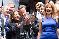 © Licensed to London News Pictures. 23/06/2015. London, UK. DAVID CAMERON poses for a selfie at the launch of the Start-Up Britain campaign routemaster bus in Downing Street, London with Prime Minister, David Cameron. Over five weeks the routemaster bus will visit 30 towns and cities - including Aberdeen, Inverness, Swansea York and Leeds - and aim to engage with 15,000 individuals through workshops and networking events, making them aware of the assistance Start-Up Britain can offer. Photo credit : Vickie Flores/LNP