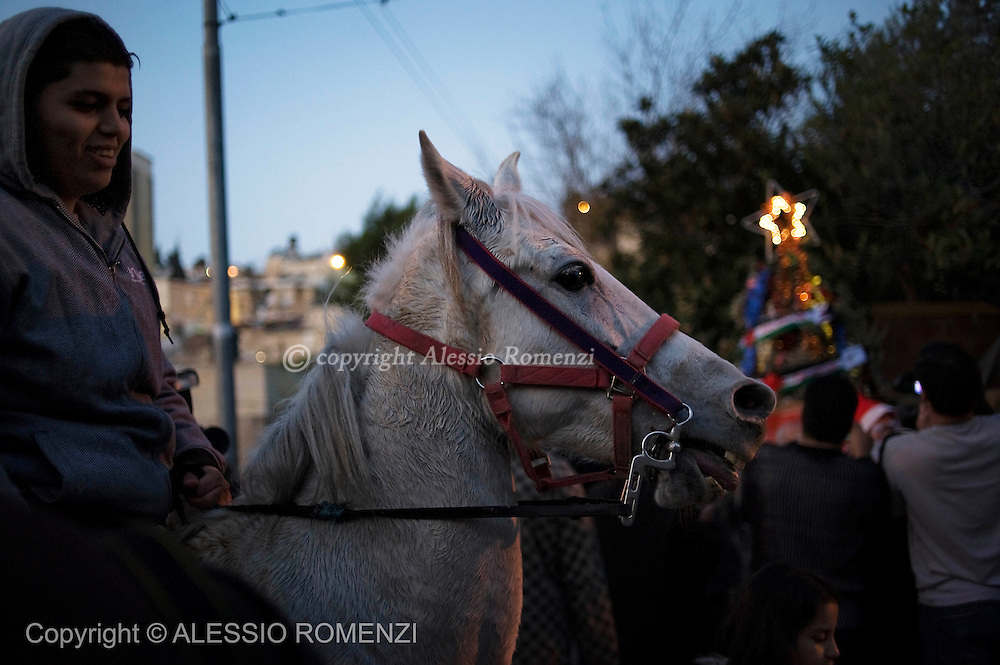A Palestinian rides a horse in front of one of the disputed houses occupied by Israeli settlers in the Sheikh Jarrah neighborhood in East Jerusalem, December 23, 2009.<br /> &copy; ALESSIO ROMENZI