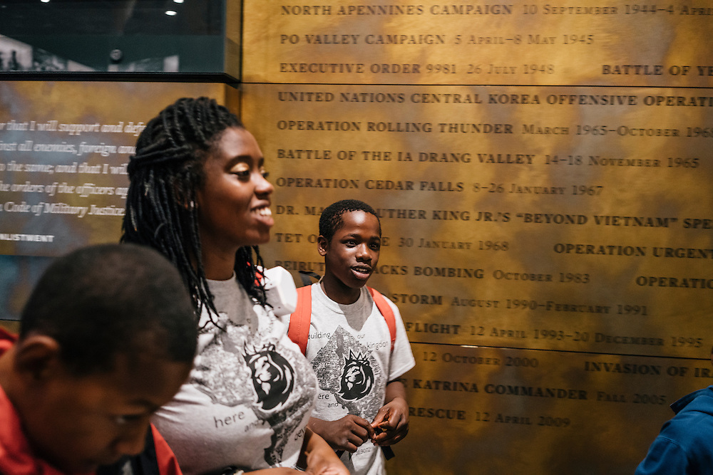 Sixth-graders from Knowledge Is Power Program (KIPP) DC, including Tay'sean Barrow, 12, center, and his teacher Gabrielle Randall, left, look at exhibits inside the Smithsonian National Musuem of African American History and Culture during their visit on Oct 21, 2016. The students spent an hour touring the new Washington, D.C. museum, which is only available to see with reserved tickets during the first year.