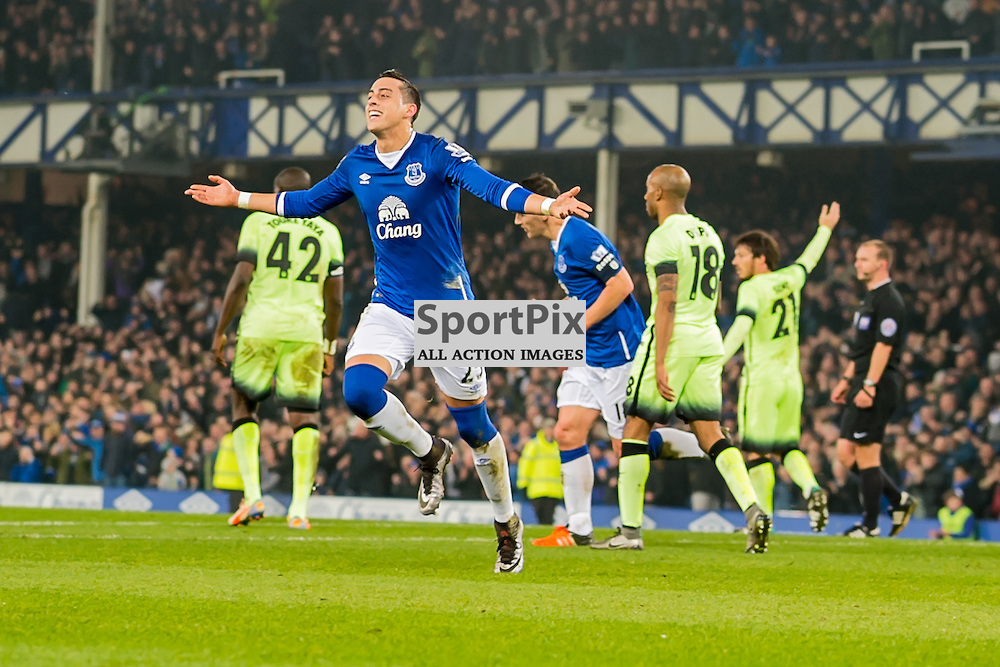 Everton defender Ramiro Funes Mori celebrates scoring the opening goal in the Football League cup semi-final first leg at Goodison Park, Liverpool
