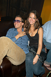 MR ALEX GILKES and MISS MISHA NONA at a Masked Ball at K Bar, 266A Fulham Road, London on 2nd September 2003.