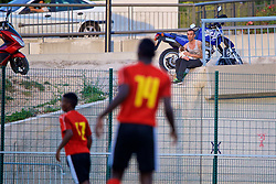 AUBAGNE, FRANCE - Monday, May 29, 2017: A supporter with his dog watches from the road during the Toulon Tournament Group A match between England U18 and Angola U20 at the Stade de Lattre-de-Tassigny. (Pic by David Rawcliffe/Propaganda)