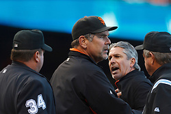 July 23, 2011; San Francisco, CA, USA;  San Francisco Giants bench coach Ron Wotus (second from right) is restrained by manager Bruce Bochy (center) while arguing with MLB umpire Sam Holbrook (34) after getting thrown out of the game against the Milwaukee Brewers during the fourth inning at AT&T Park.