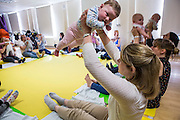 A mother and toddler group taking place at the Percy community centre, Bath. With the help and support of Bath and West Community Energy they have a solar PV array on their roof and have installed energy efficient (LED) lightbulbs throughout their centre. Bath, Somerset.