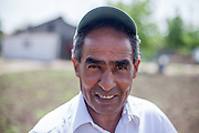 Portrait of a local inhabitant working on his field in the Roma area of Frumusani.