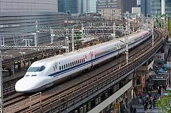 Modern shinkansen bullet train in central Tokyo Japan