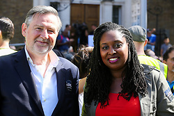 © Licensed to London News Pictures. 31/08/2019. London, UK. Barry Gardiner, Shadow Secretary of State for International Trade (L) and Dawn Butler, Shadow Women & Equalities Secretary (R) at the rally in Whitehall as tens of thousands of protesters demonstrates outside Downing Street in London against British Prime Minister Boris Johnson's plans to suspend parliament for five weeks ahead of a Queens Speech on 14 October, just two weeks before the UK is set to leave the EU. Photo credit: Dinendra Haria/LNP
